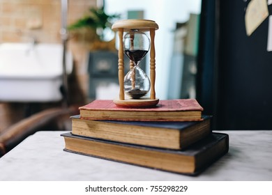 Hourglass in vintage style with old books, Antique Sand Clock, Read  concept