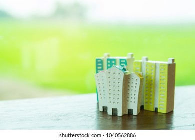house and apartment building miniature models with nature background,Mortgage concept.