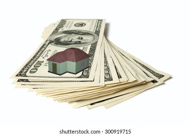 A house atop a pile of cash represents the rising cost of homeownership.