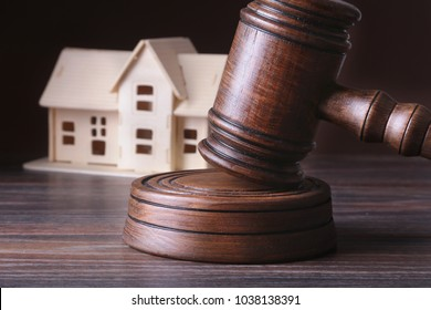 House Auction, auction hammer , symbol of authority and Miniature house . Courtroom concept.