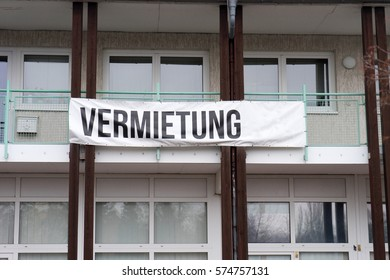 house with a banner and the german word rental