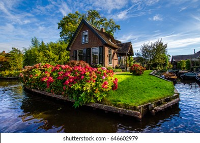 House with beautiful flowers on small island in Giethoorn,a typical Dutch village