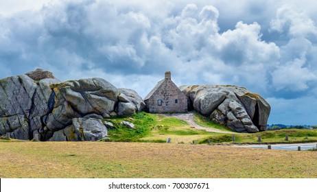 House between the rocks in Meneham village, Kerlouan, Finistere, Brittany (Bretagne), France