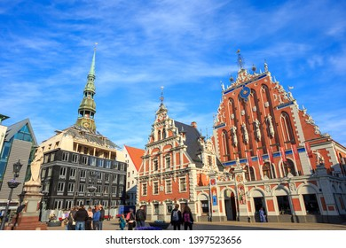 House of the Blackheads (Melngalvju nams) - historical building on Town Hall Square in Riga, the capital of Latvia, on a sunny day under a blue sky with an interesting pattern of high cirrus clouds.