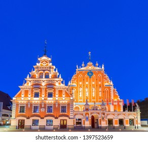 House of the Blackheads (Melngalvju nams) - ornate historical building on Town Hall Square in Riga, the capital of Latvia, at night, artificially illuminated, under clear, dark blue sky. Copy space.