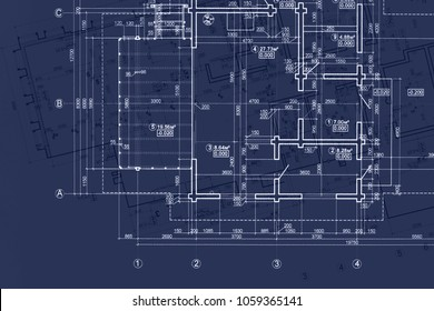 house blueprint on architects desk, engineering drawings and plans on dark blue background
