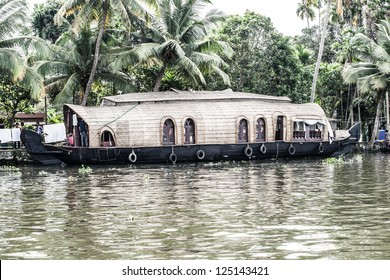 House boat in backwaters near palms in Alappuzha, Kerala, India ( HDR image )