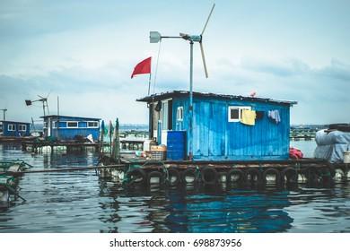 House boat on the open water / in the ocean / seashell farmer