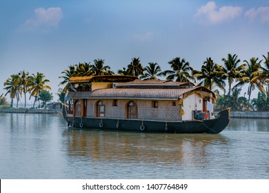 House boat sailing through Kerala backwaters