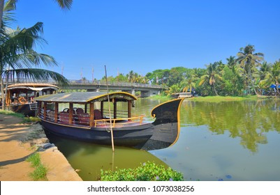 House boats parked by in kumarakom backwaters.