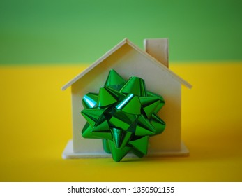 House with a bow as a gift, building for sale