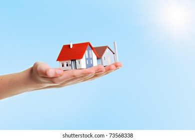The house in boy's hands