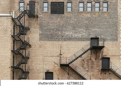 House brick wall with fire escape in Chicago