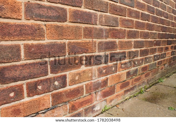 house brick wall that has had spray foam cavity wall insulation and the holes  filled with cement
