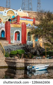 A house in bright colors of Nubian style on the Nile, August 12, 2015