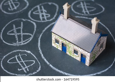 House bubble boom presentation on chalkboard. Concept photo of Real estate market bubble, housing market, subprime mortgage crisis Home loans, Mortgage loans. No people. Copy Space