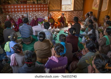 House Buddhist blessing ceremony, Shan State, Burma, March 2012: A group of villagers and Buddhist monks celebrate inside Buddhist house blessing ceremony