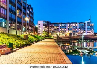 House building and city construction concept: evening outdoor urban view of modern residential real estate district homes