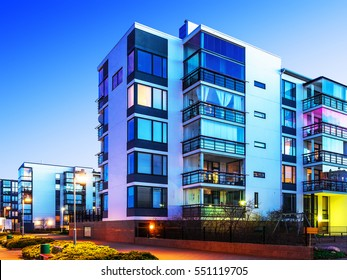 House building and city construction concept: evening outdoor urban view of modern real estate homes