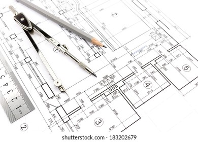 House building construction plans with pencil and drawing compass