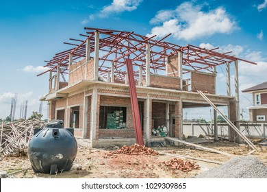 house building structure at construction site with clouds and blue sky