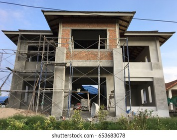 House built with concrete and brick