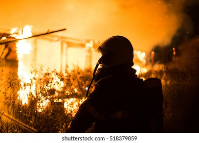 House Burning Down With Firefighter