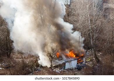 House burning with intense flames horizontal close up image