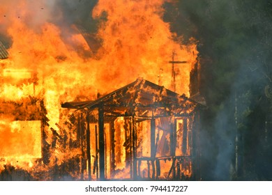 House burning with intense flames. Horizontal close up image.