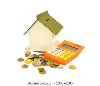 House, calculator and coins, Buying property concept