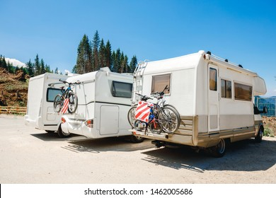 House camper on the wheels, travel in vacation. Camper with bicycles on a camping site. caravan car summer holidays by the sea sunny morning