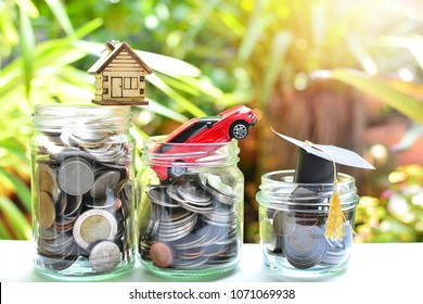 house, car and hat education model on coins saving for concept investment mutual fund finance basic life and insurance