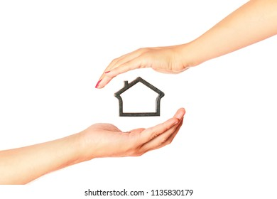 House care concept. House mockup between man and woman hands isolated on white background.