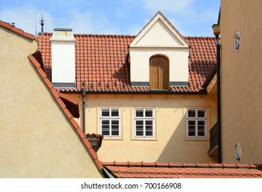 House with a ceramic shingles roof with chimney and Rain Gutter.
