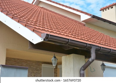 House ceramic tiled roof with pvc rain gutter pipe.
