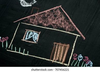 house chalk drawing on blackboard background selective focus macro