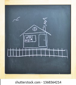 House. Children's drawing on the blackboard