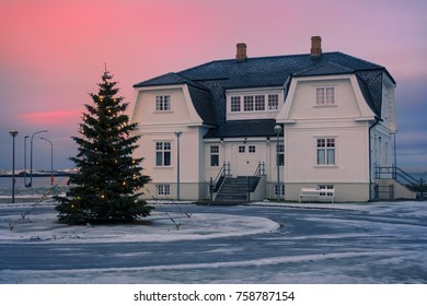 Höfði house at Christmas in the city of Reykjavik, Iceland. Typical house of wood and Christmas tree placed outside. Here, Mikhail Gorbachev,and Ronald Reagan, celebrated the Reykjavik summit