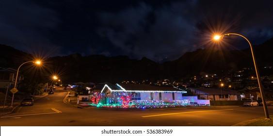 House with Christmas decorations lights ; night photo taken in the Hawaiian islands, Hawaii