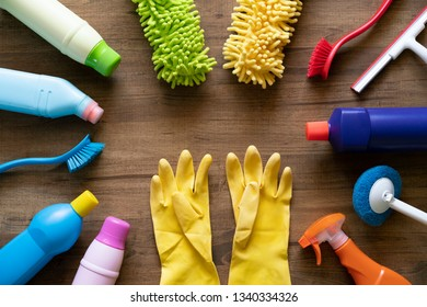House cleaning product and glove on wood table
