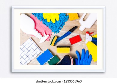 House cleaning products. Sponges and chemicals bottles. Rubber gloves, towel and washcloth. Household equipment. Wall frame poster with cleaning equipment photo. Mockup template.