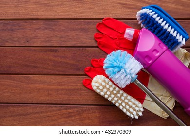 House cleaning set on wooden background