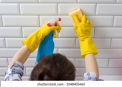 House cleaning. Woman doing chores in bathroom at home