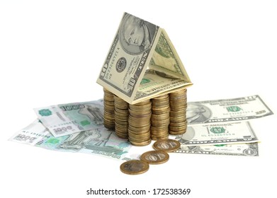 House of coins and banknotes isolated