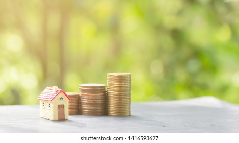 house and coins stack for saving to buy a house. Property investment and house mortgage financial concept