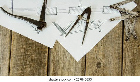 House construction. Many drawings for building and old working tools on old wooden background.