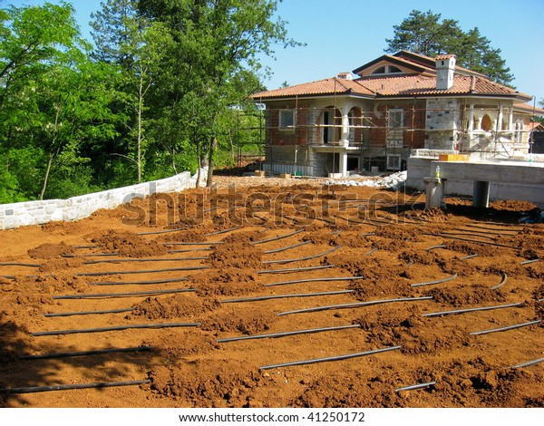 House construction site in europe with heating tubes eco