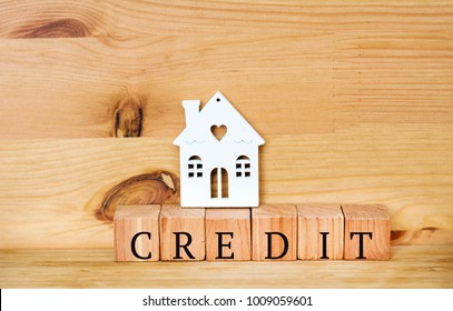 House Credit Text with Small House