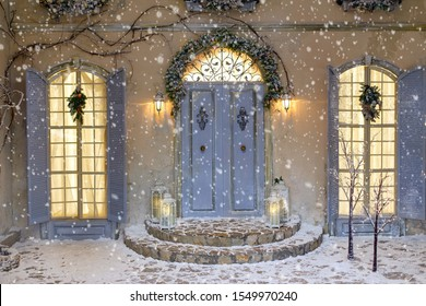 House decorated for Christmas outside. Vintage courtyard interior with stairs, porch, door and lights in windows. Winter christmas background.
