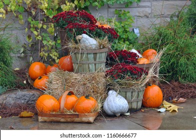 House decorated with pumpkins and fall leaves for Thanksgiving day and Halloween, New England. USA